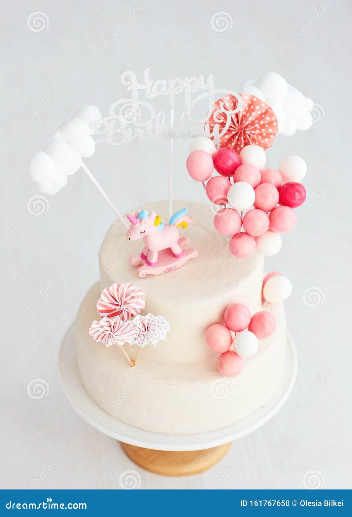 Groovy Baby Girl Birthday Cake With Unicorn And Balloons Stock Photo Birthday Cards Printable Giouspongecafe Filternl