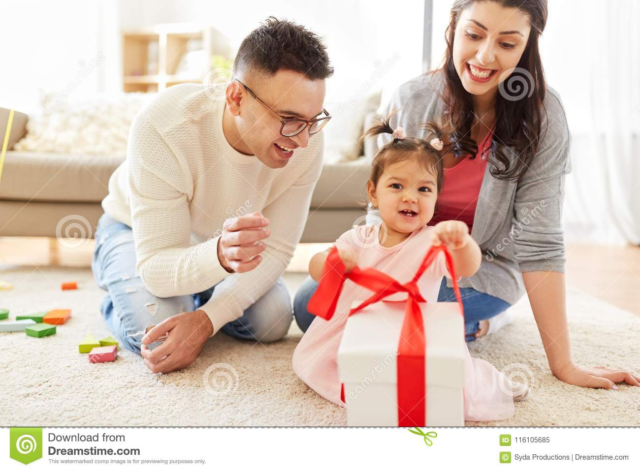 Baby Girl With Birthday Gift And Parents At Home Stock Image Image