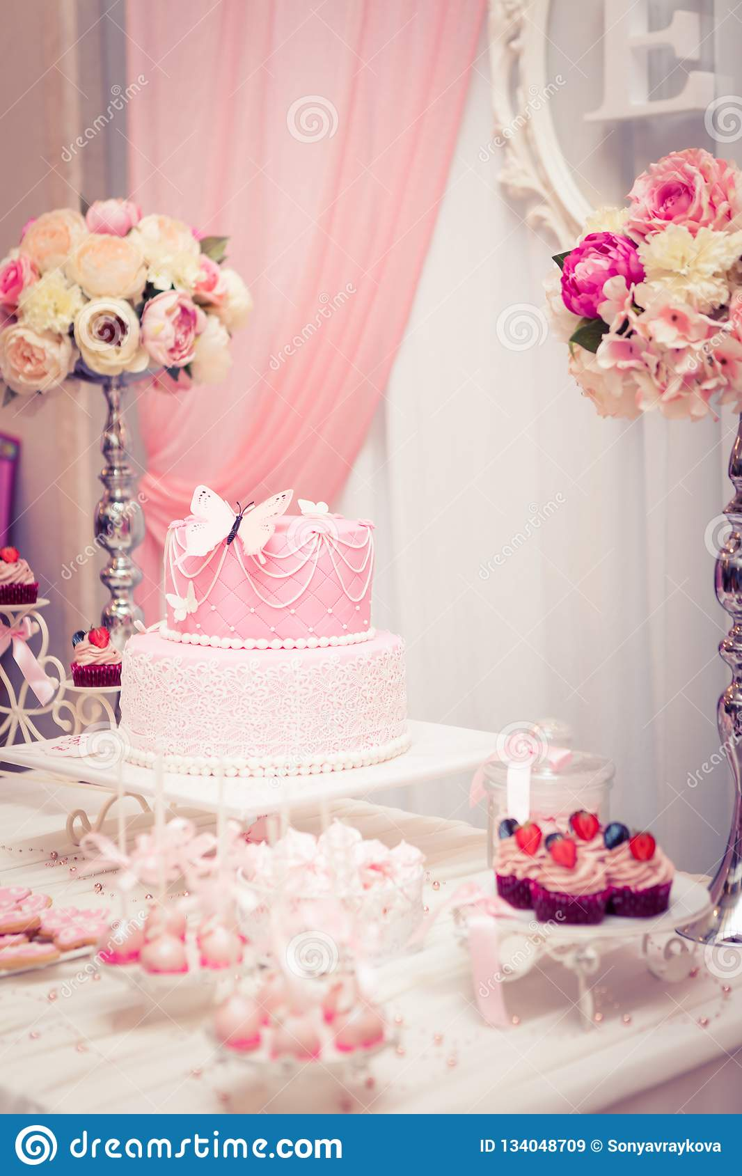 Table Set For Baby Girl Birthday Party With Beautiful Cake And Candy Theme Flower Masterpiece