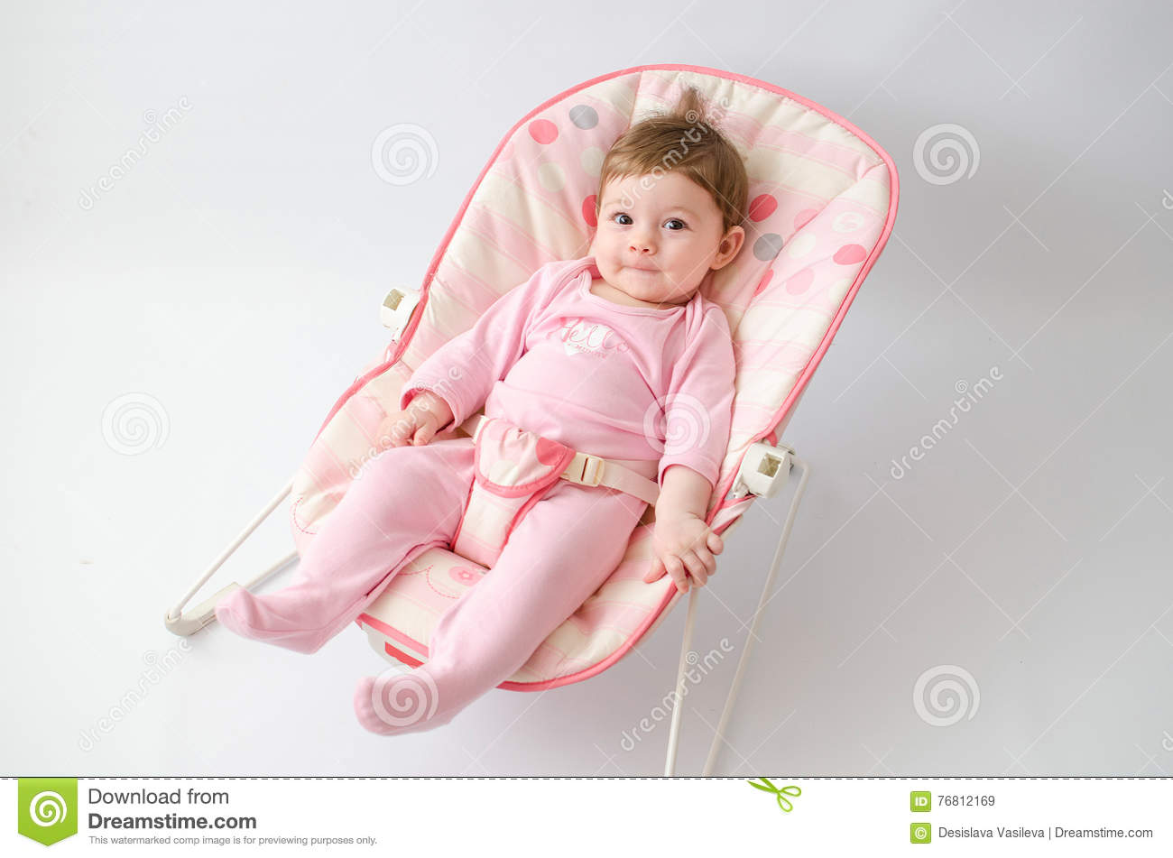 0ae1620cc Baby girl on a bouncer stock image. Image of child