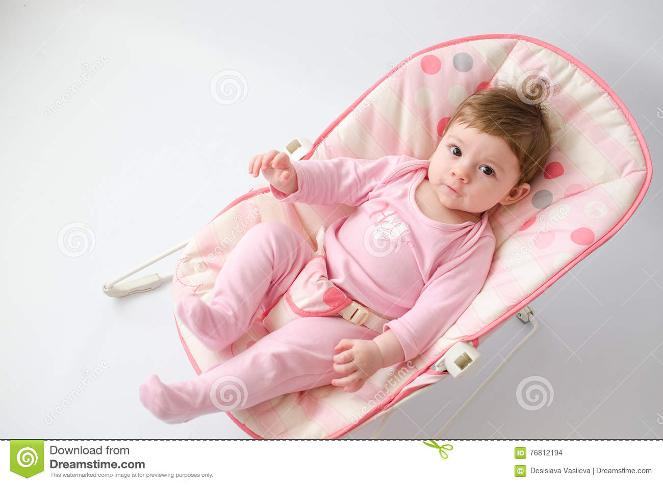 84b81691c Baby girl on a bouncer stock photo. Image of comfortable - 76812194