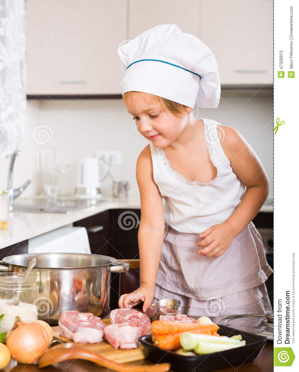 Baby Girl Cooking With Meat Stock Image