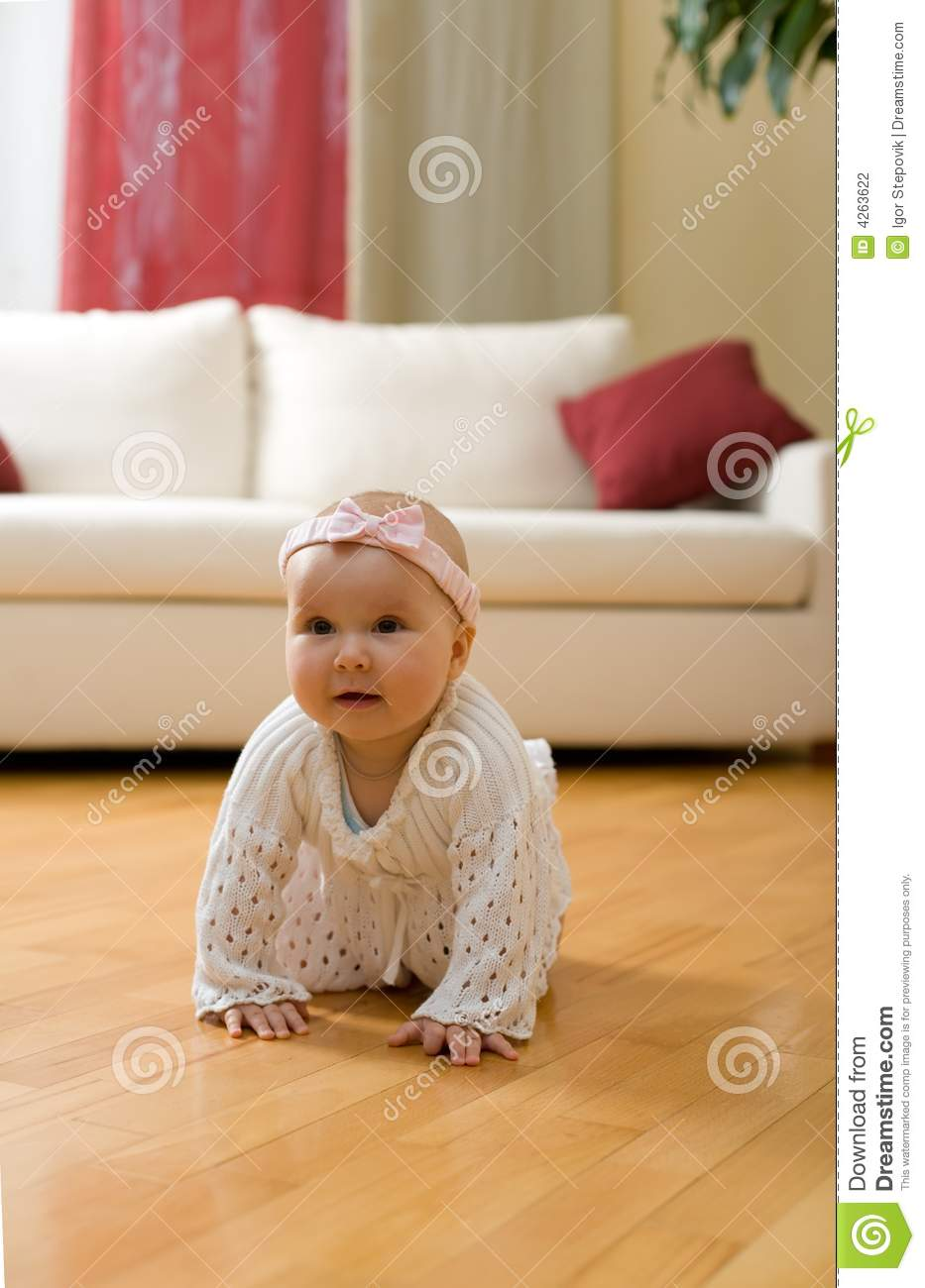 Baby Girl Crawling On A Floor Stock Photography Image