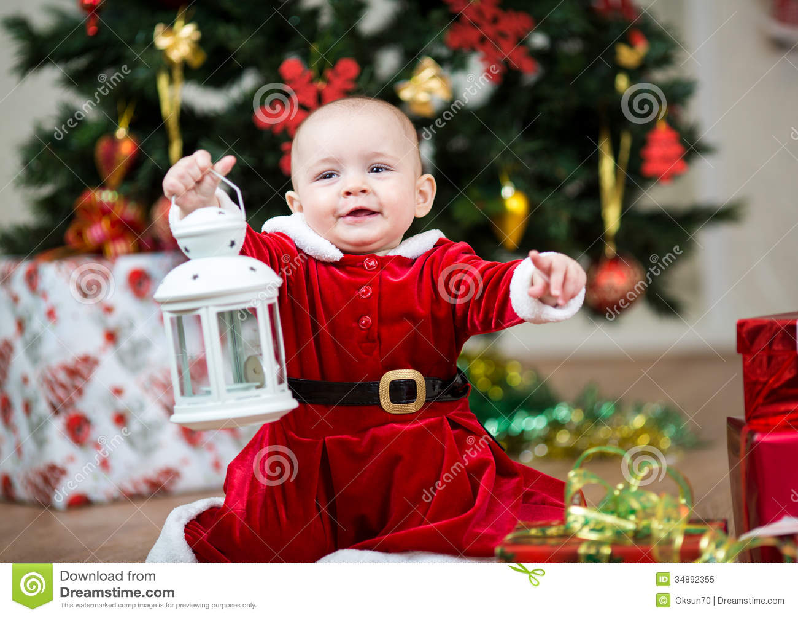 Baby Girl Dressed As Santa Claus At Christmas Tree Royalty Free ...
