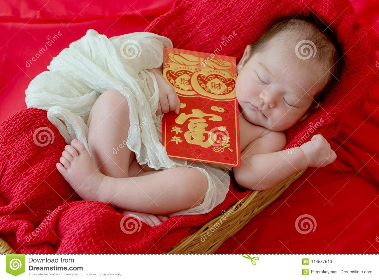 baby girl with gesture of happy chinese new year