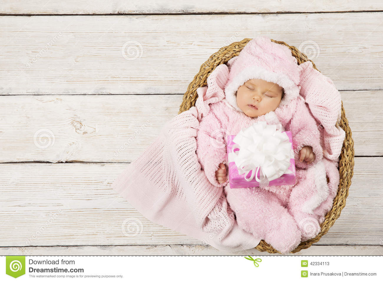 Baby girl with gift sleeping on wooden background newborn in ba download baby girl with gift sleeping on wooden background newborn in ba stock image stopboris Choice Image