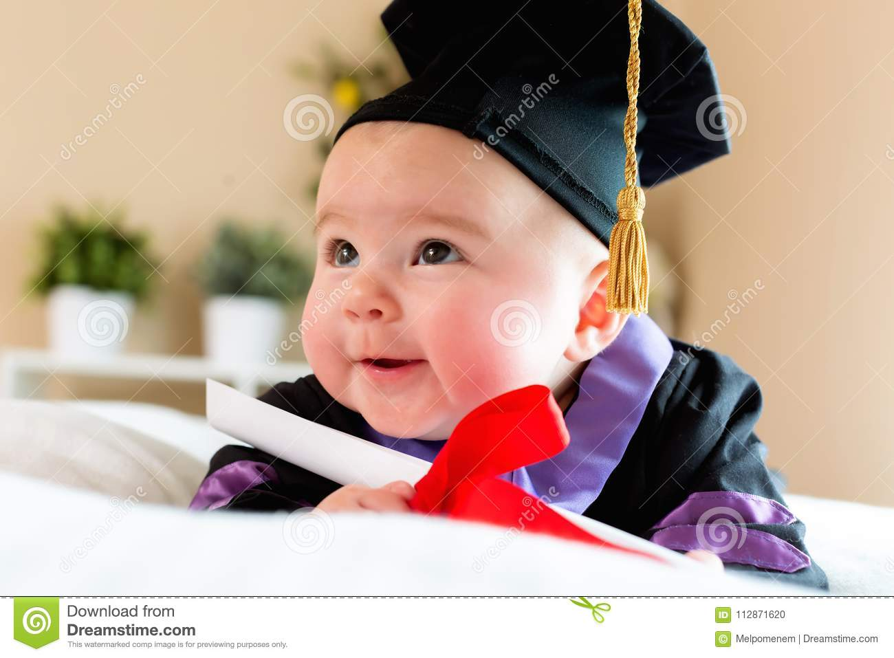 Baby Girl In Graduation Cap And Gown Stock Photo - Image of concept ...