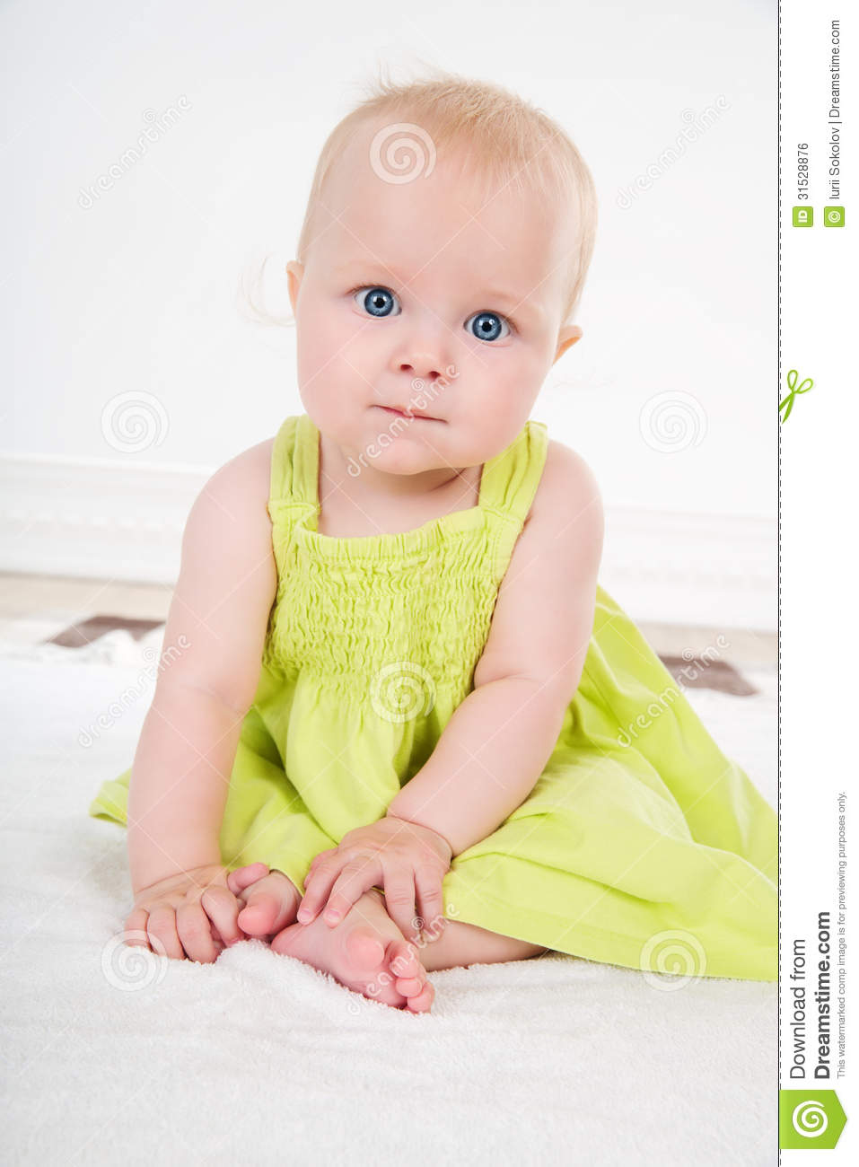 45afc37848b9 Baby girl in green dress stock photo. Image of lifestyles - 31528876
