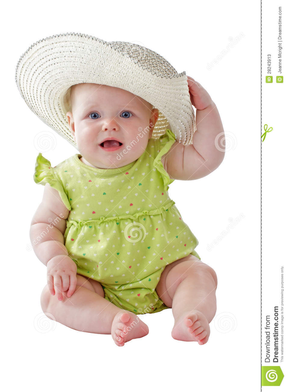 Baby Girl In Green Dress Sits Wearing Big Straw Hat Stock