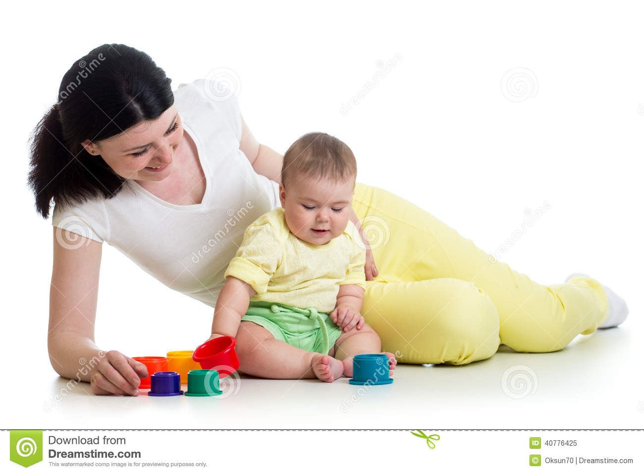 Girl Toys Color : Baby girl and mother playing with color toys stock photo