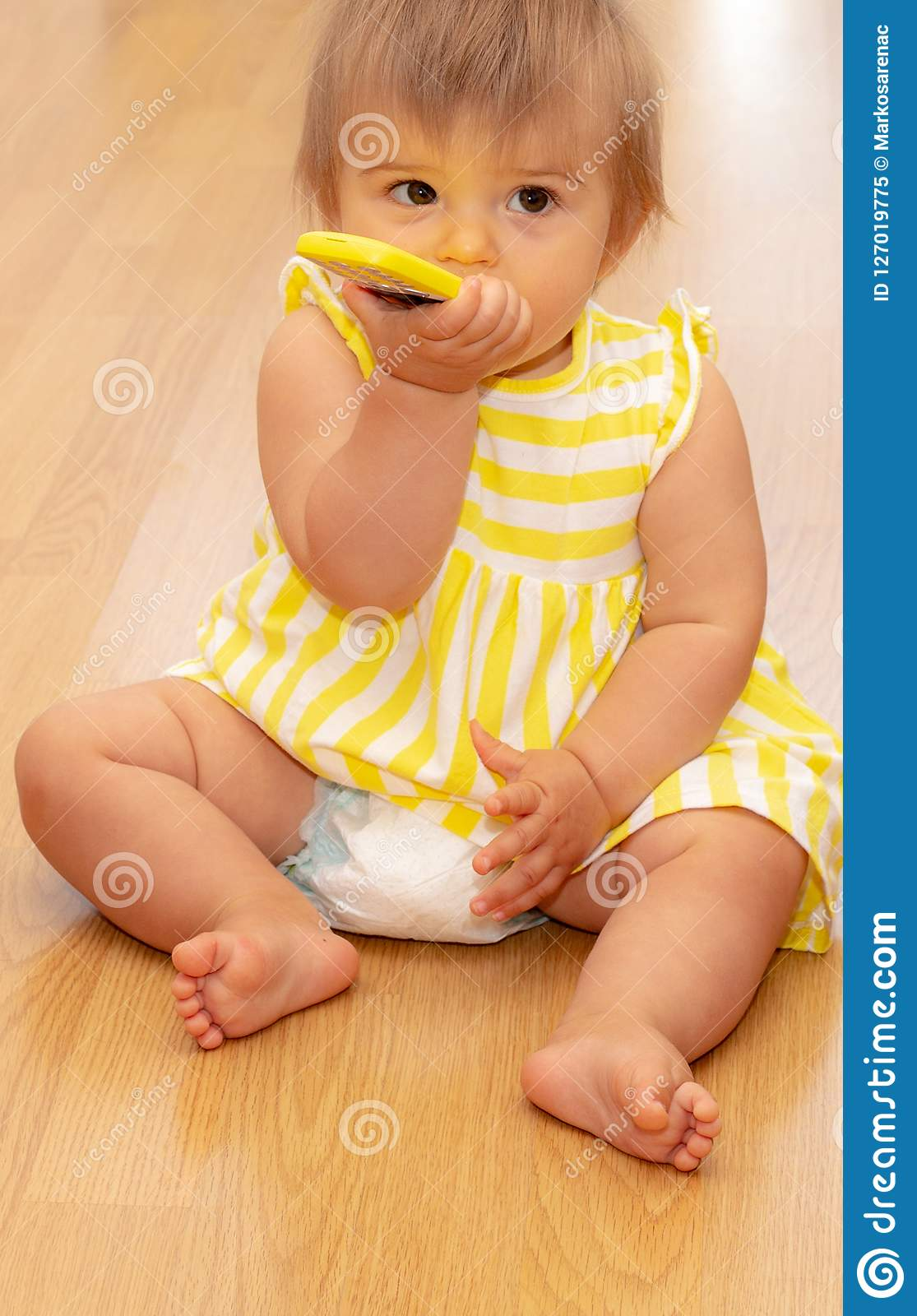 Baby Girl Phone Yellow Dress Cute 2 Stock Image Image Of Gladness Generation 127019775