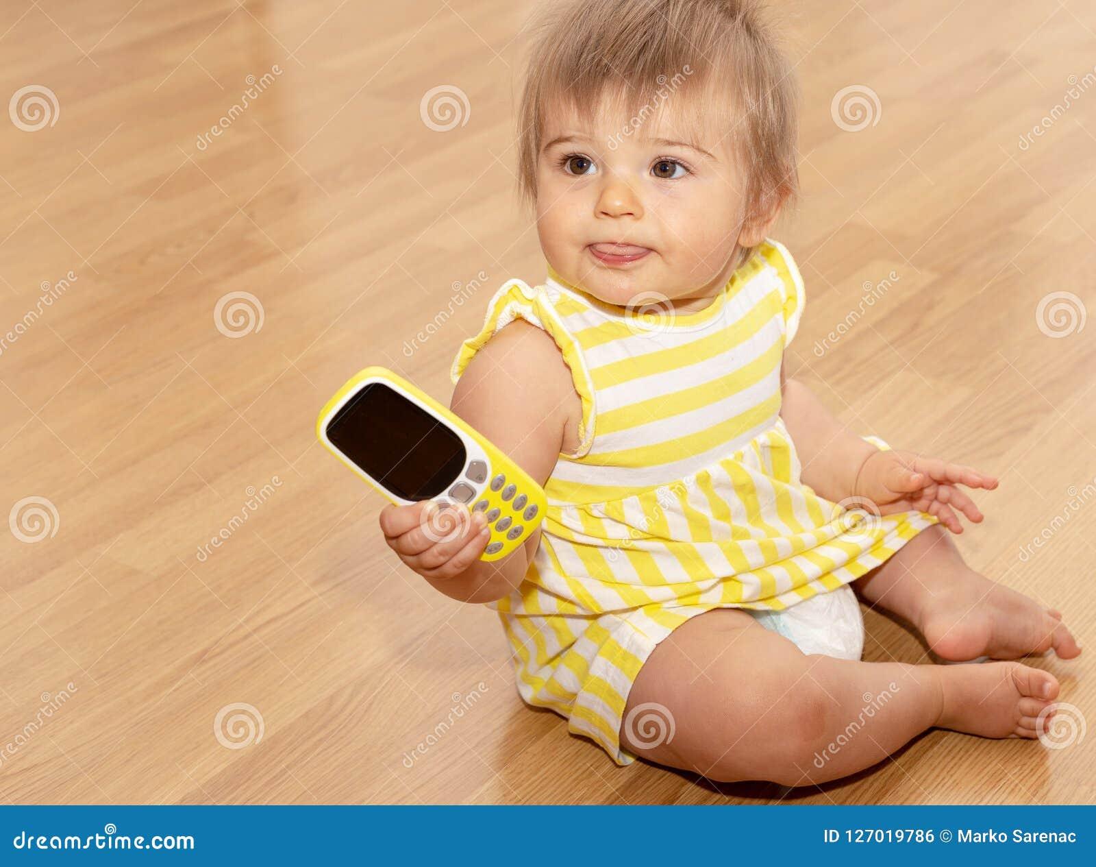 Baby Girl Phone Yellow Dress Cute 5 Stock Photo Image Of Child Happiness 127019786