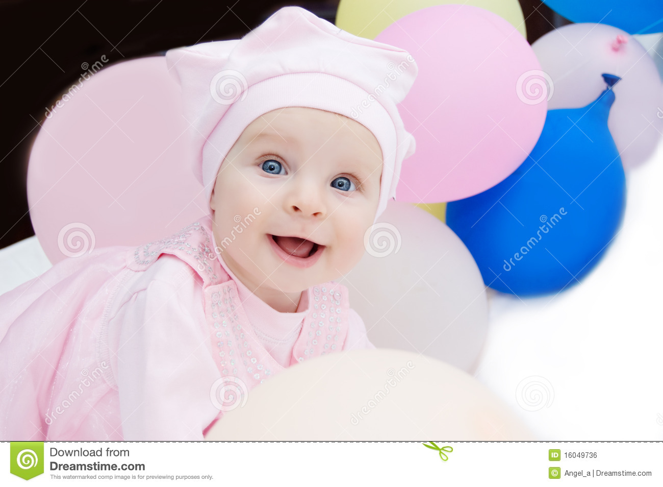 Baby girl in pink with balloons