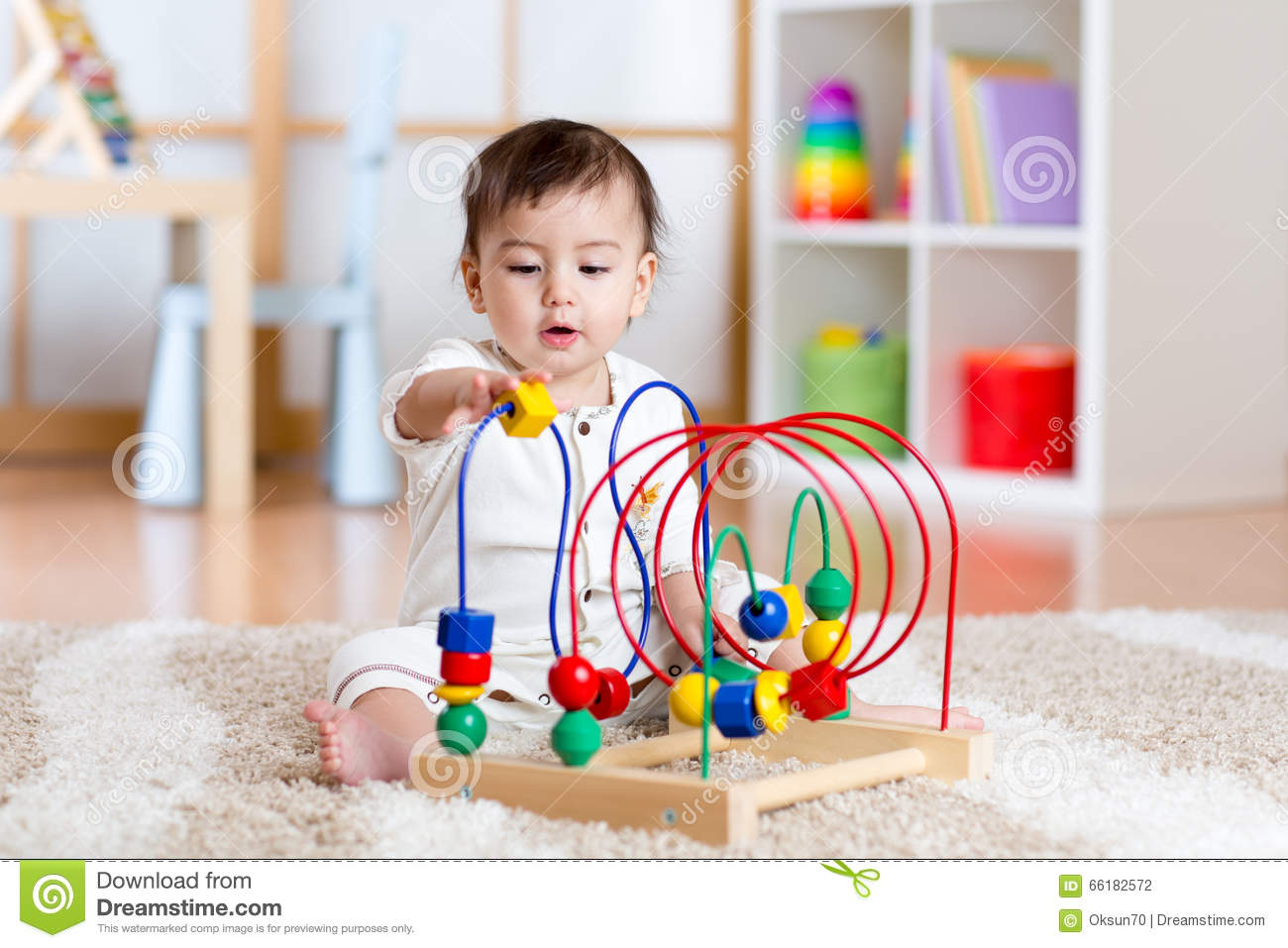 Toddler Girl Learning Toys : Baby girl playing with educational toy in nursery stock