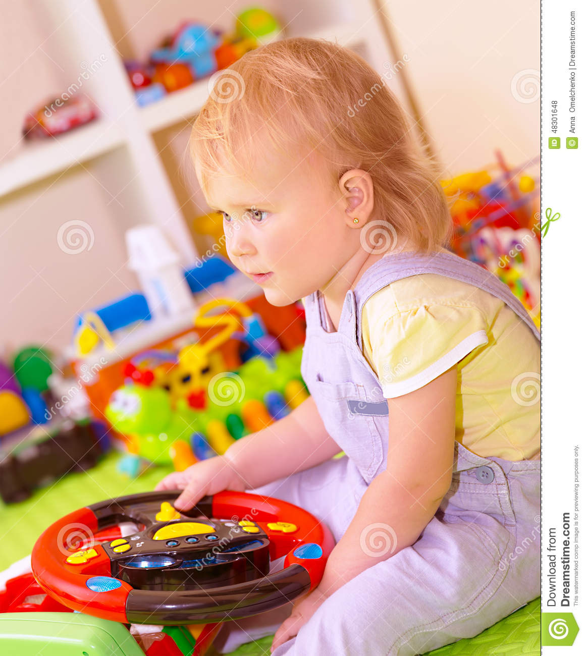 Baby Girl In Playing Room Stock Photo