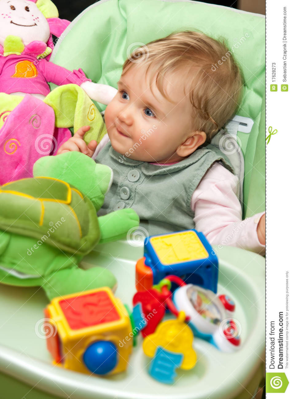 Newborn Baby Girl Toys : Baby girl playing with toys stock image