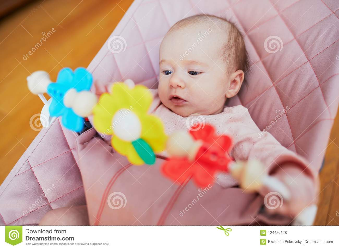 2c549d5ebf4d Baby Girl Playing With Toys In Bouncer Stock Photo - Image of play ...