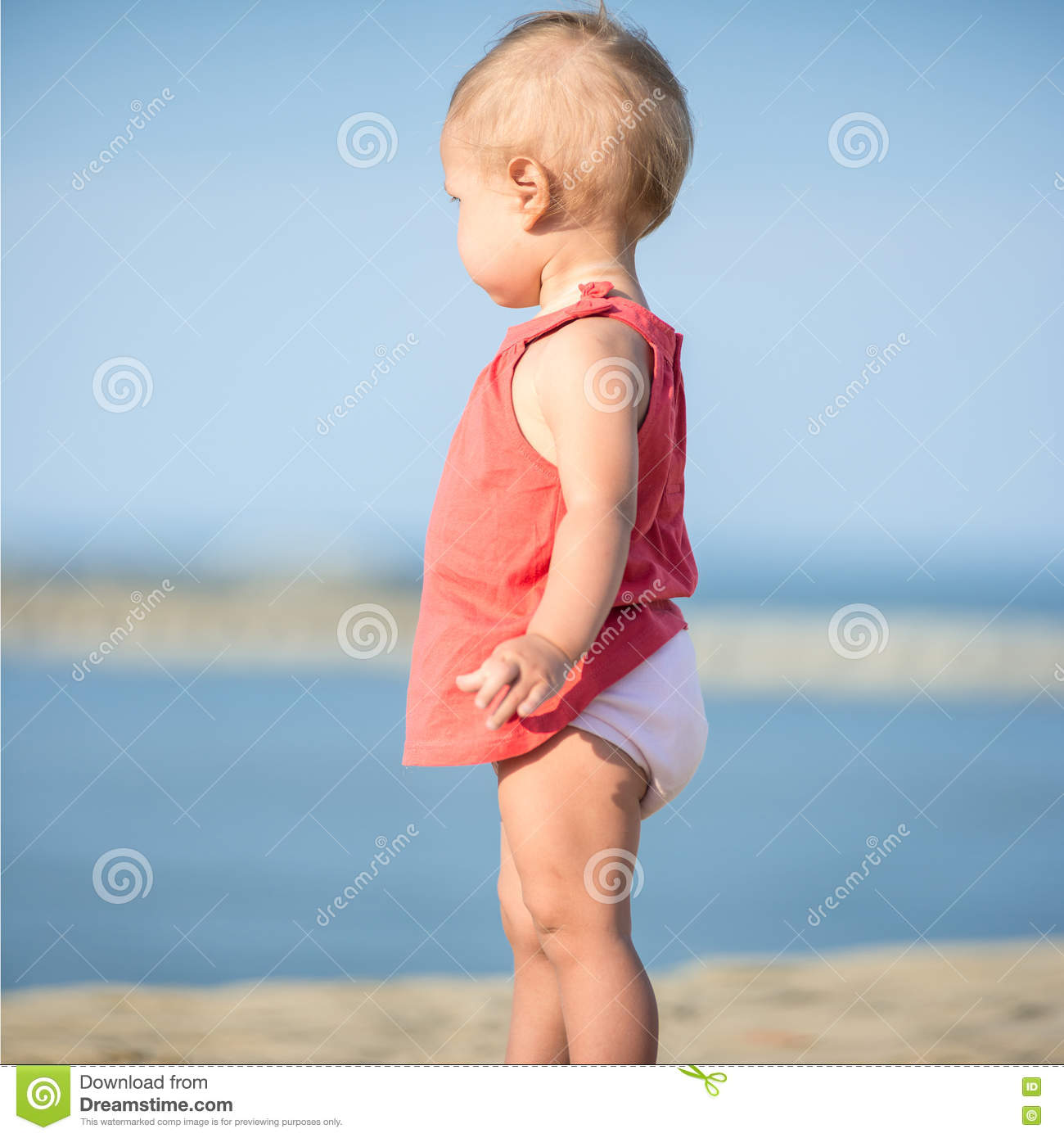 Adorable Little Girl Playing With Beach Toys During: Baby Girl In Red Dress Playing On Sandy Beach Near The Sea