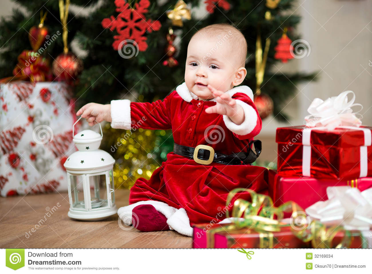 Baby Girl Santa Claus In Front Of Christmas Tree Stock Photo ...