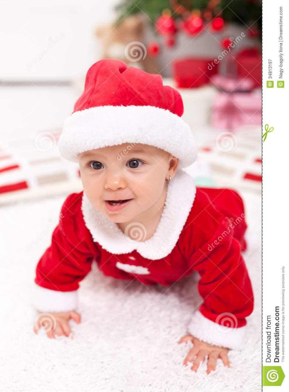 Baby Girl In Santa Outfit Crawling Royalty Free Stock Photography ...