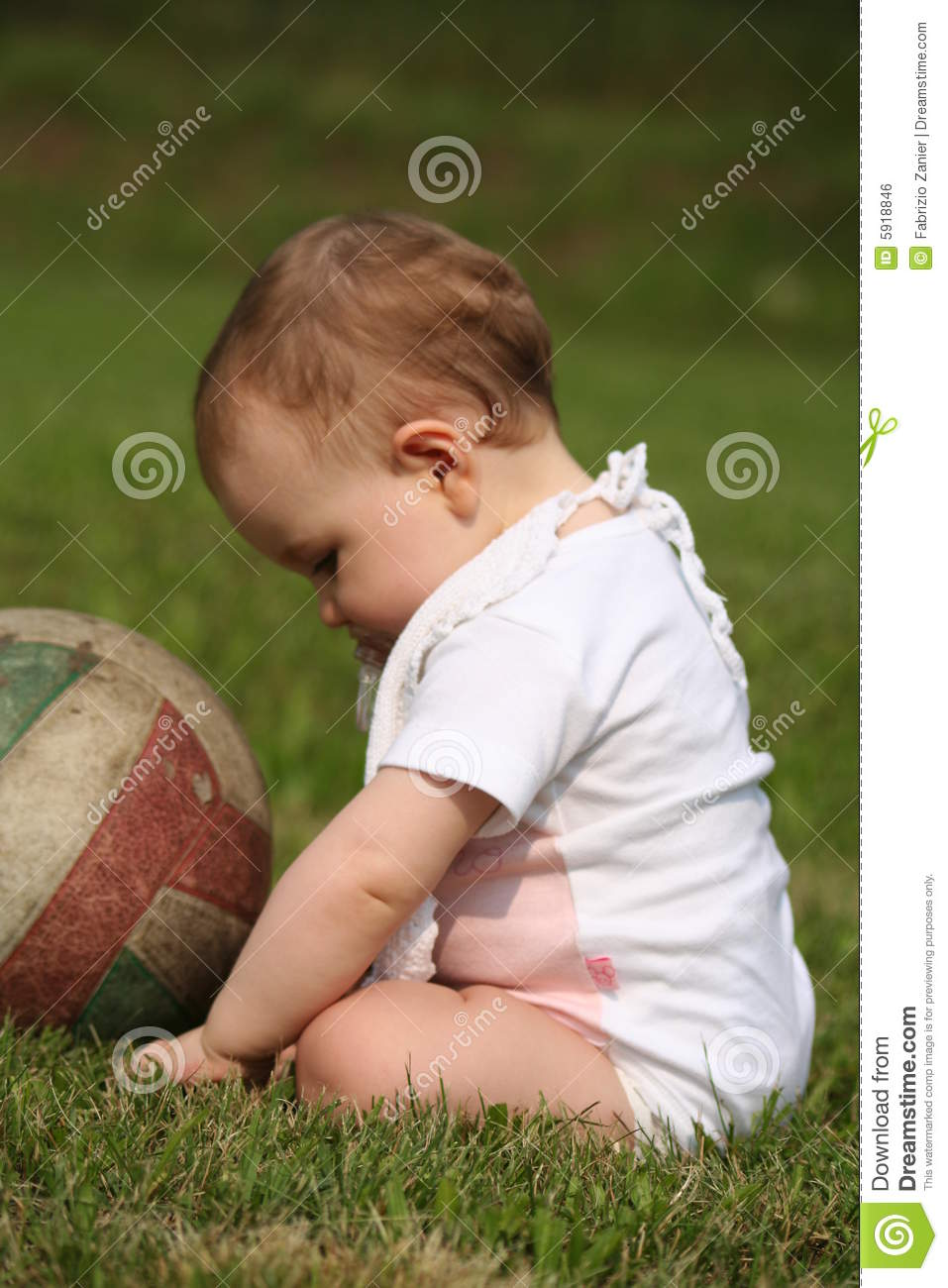 Baby Girl Sit At Grass Royalty Free Stock Image