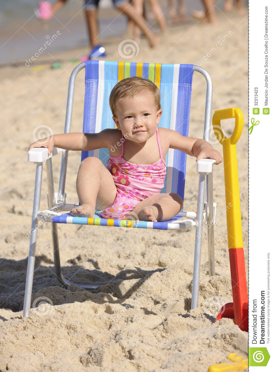 Baby girl sitting on a beach chair stock image image for Toddler sitting chair