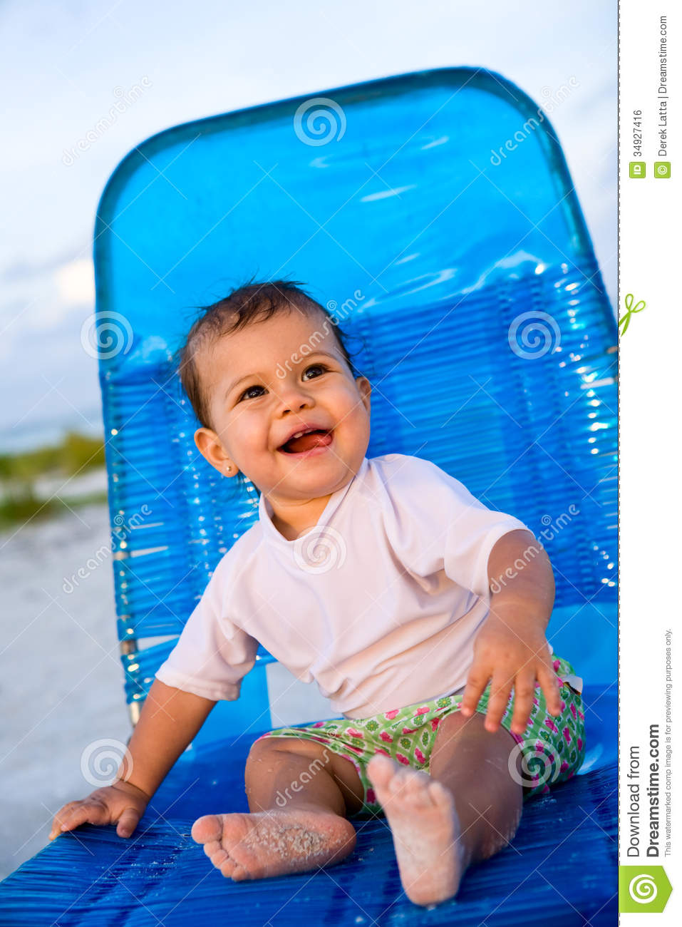 Baby girl sitting on beach chair stock photo image 34927416 for Toddler sitting chair