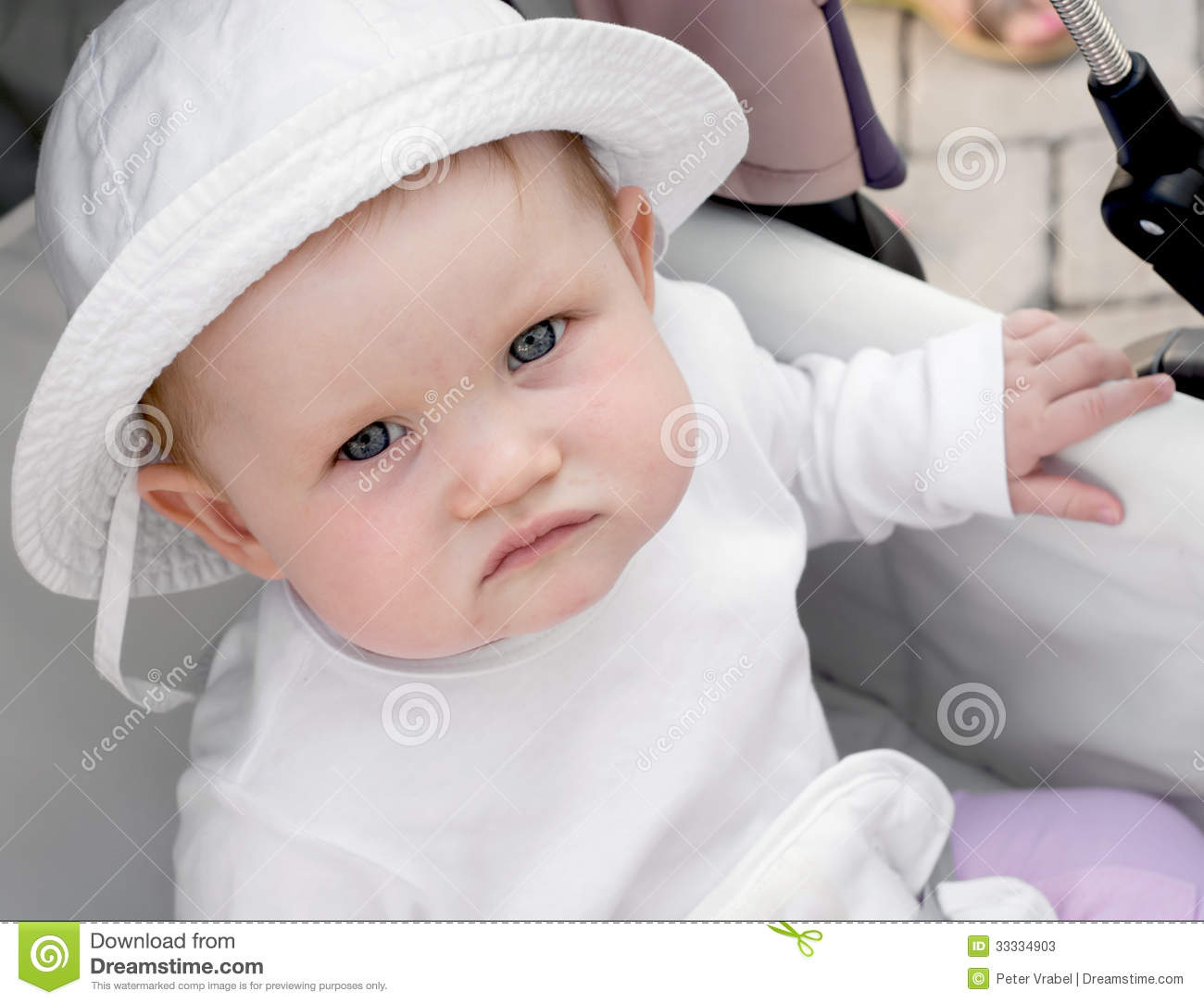 Baby girl sitting in a stroller stock photos image 33334903