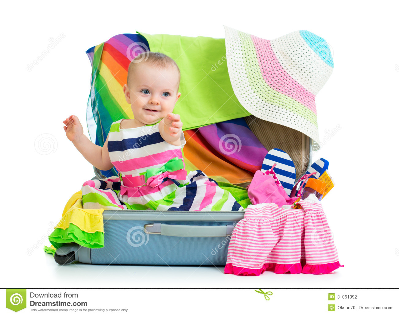 Baby Girl Sitting In Suitcase Stock Photo