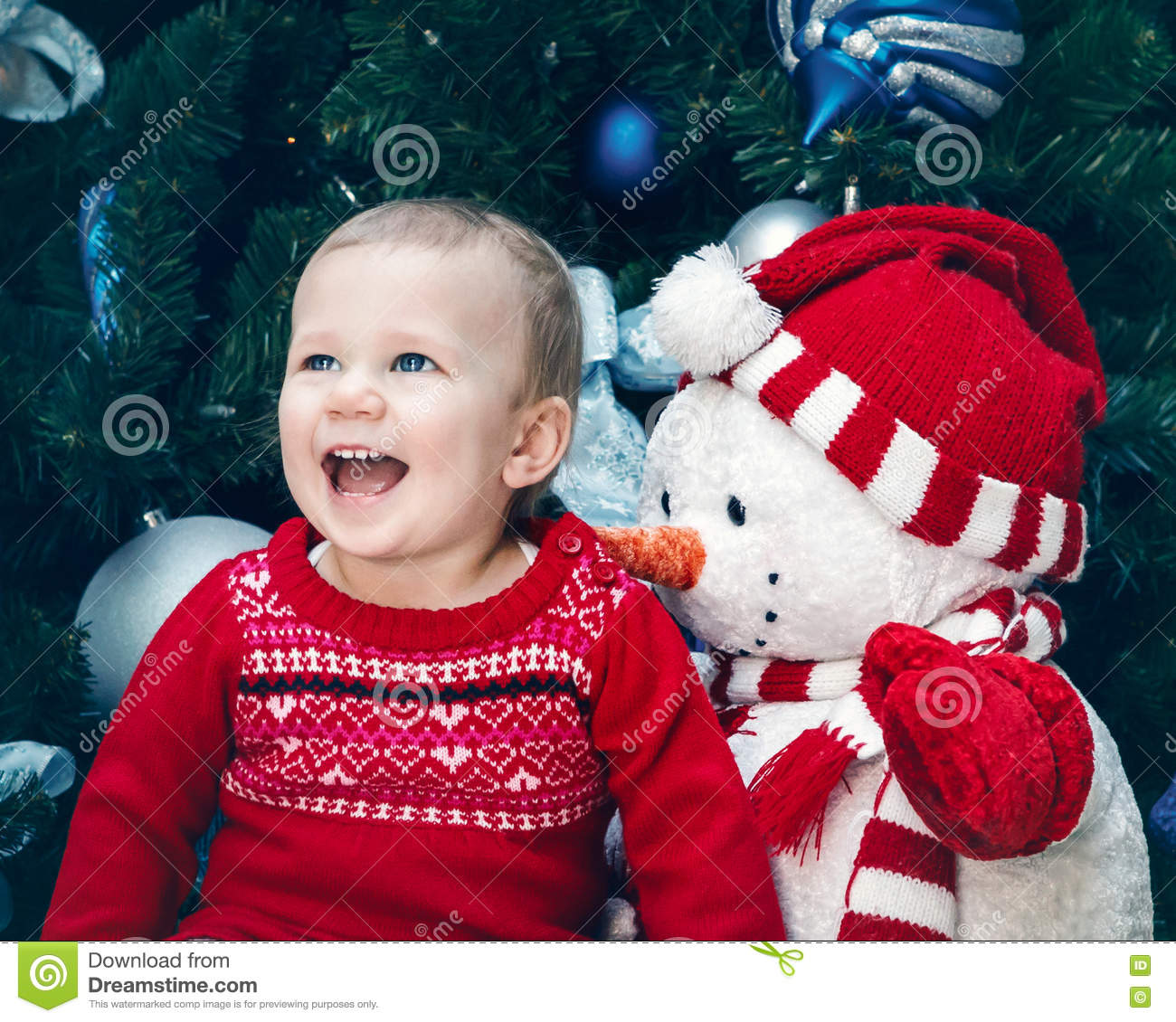 0c04bbdf9 Baby Girl Toddler With Blue Eyes In Red Dress Sitting By New Year ...