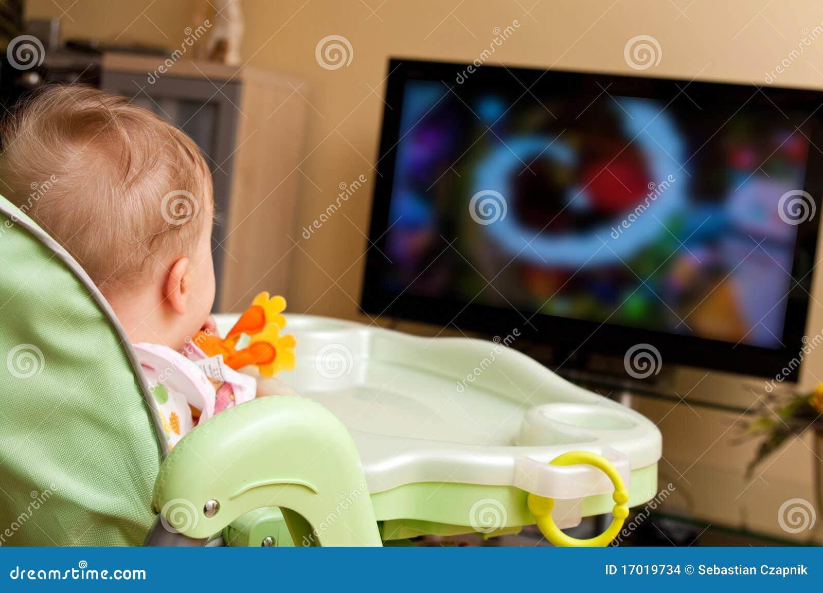 Baby girl watching tv