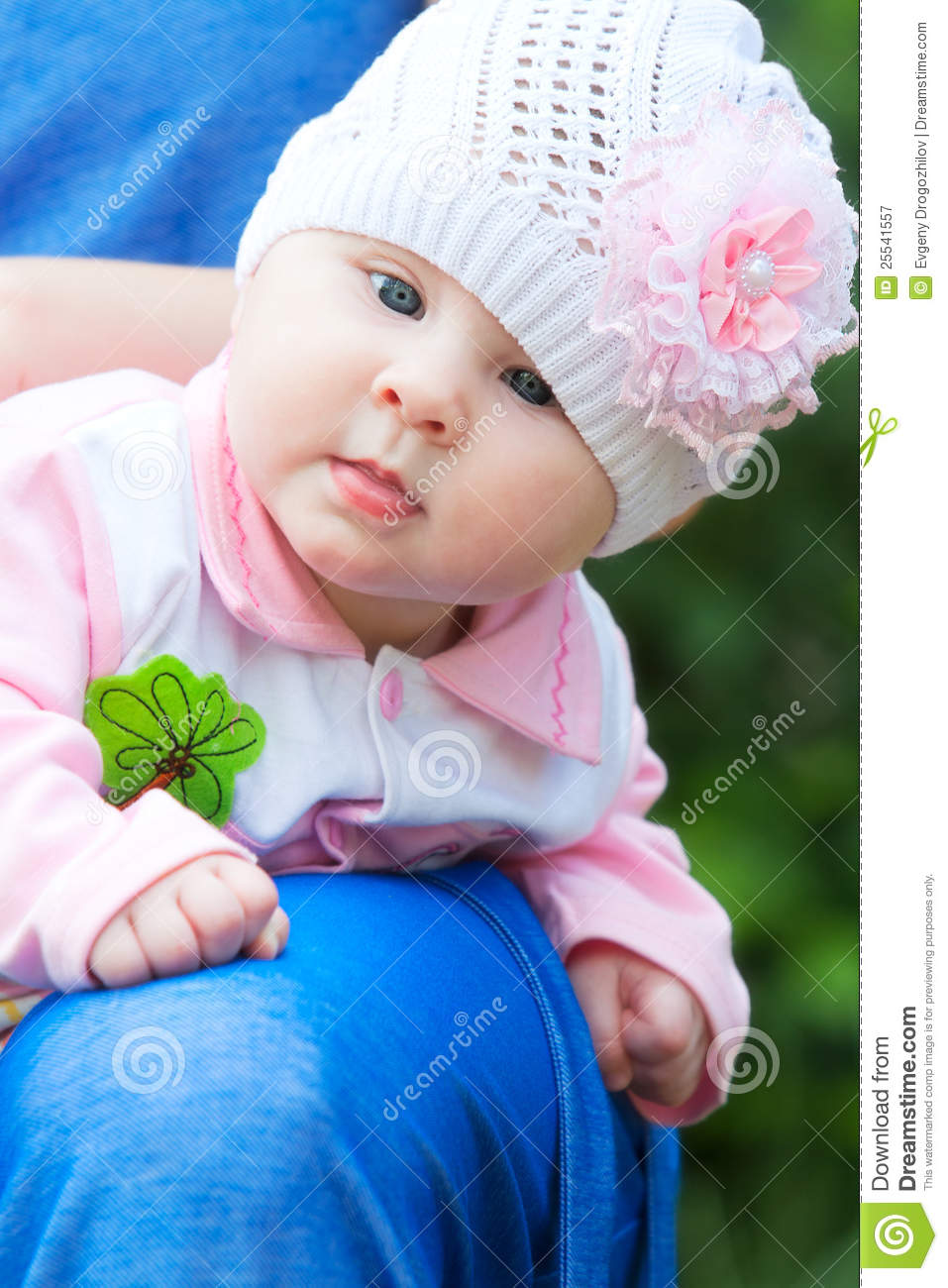 baby girl wearing knit hat with pink flower stock image - image of