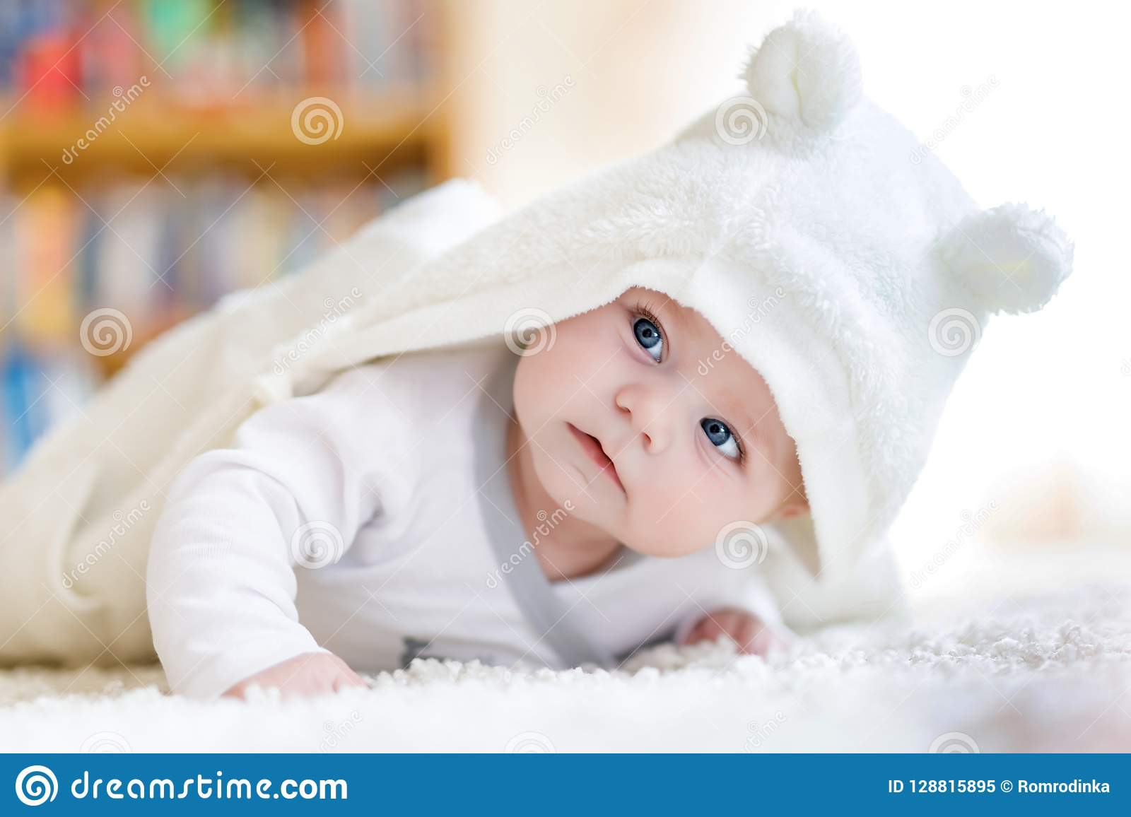 dc093618143a Baby Girl Wearing White Towel Or Winter Overal In White Sunny ...