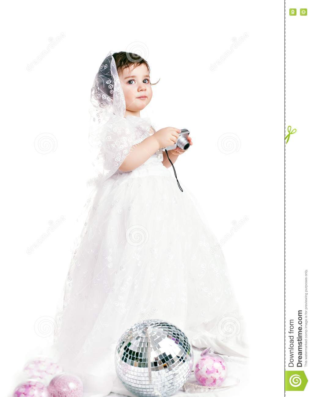 Baby girl in a white wedding dress stock photo image for Wedding dresses for baby girls