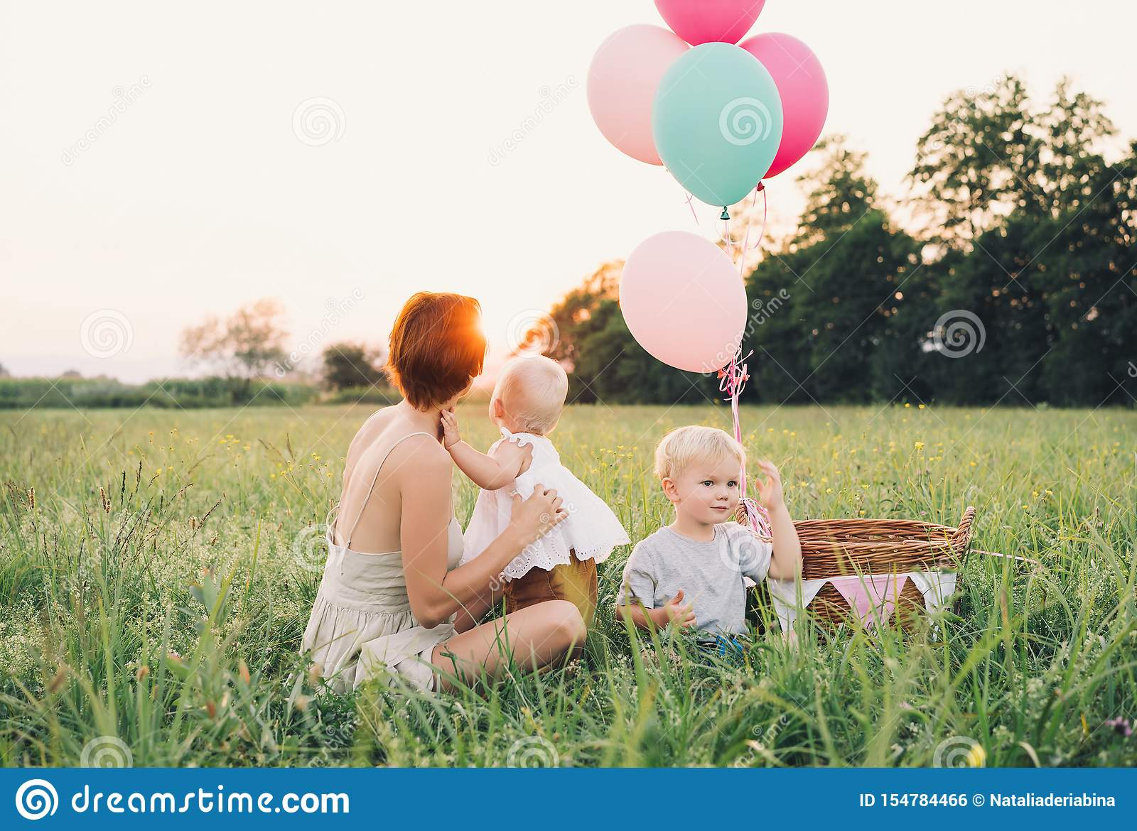 Mother and baby outdoors. Family on nature