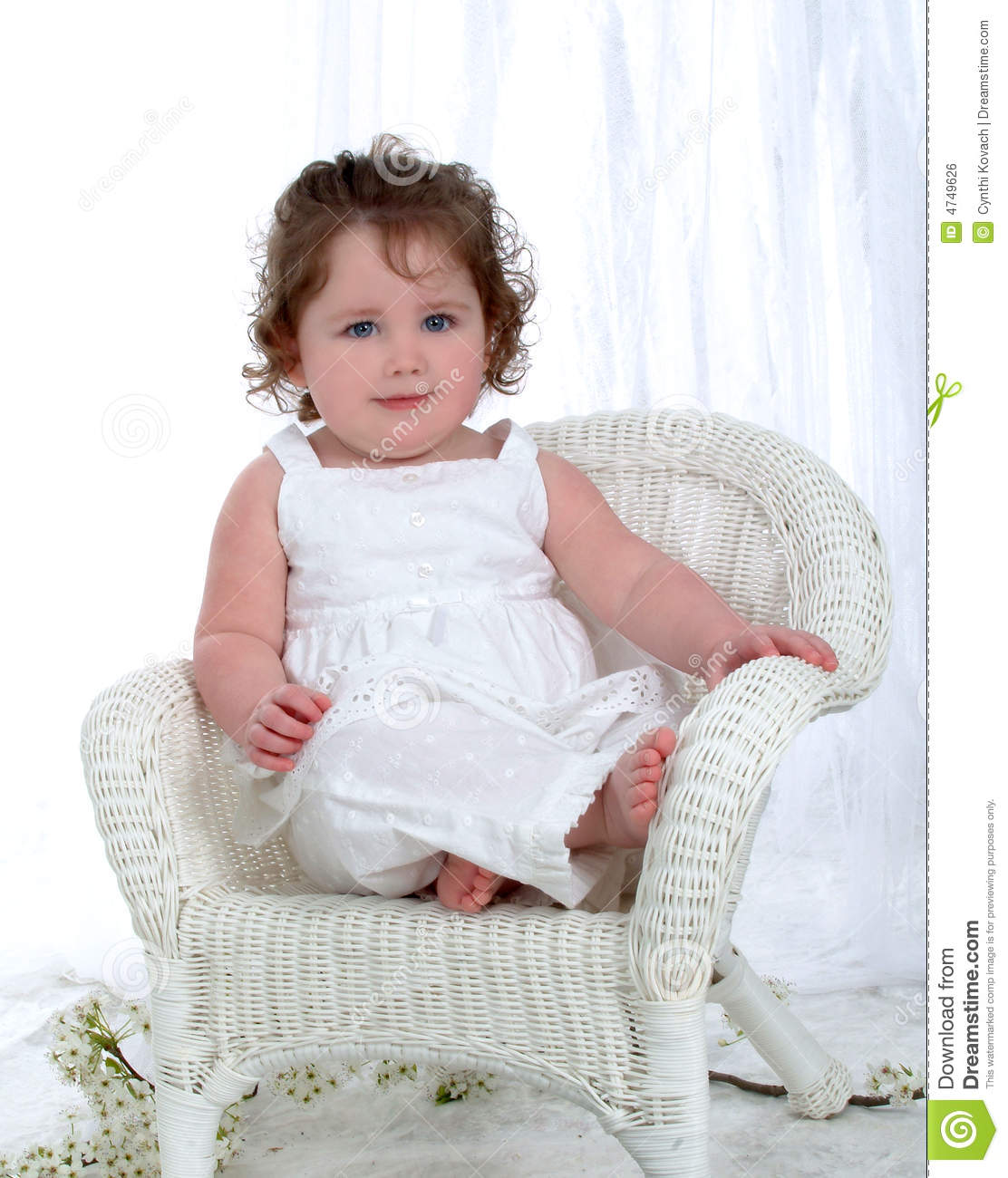 Baby Girl on Wicker Chair