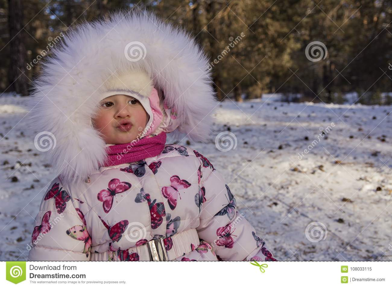Baby girl at winter. Winter portrait.