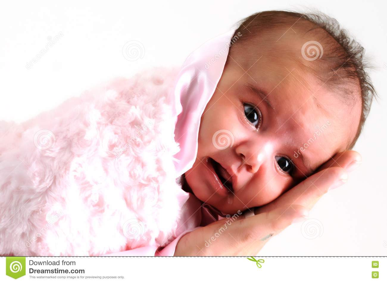 baby girl wrapped in pink blanket held by father stock