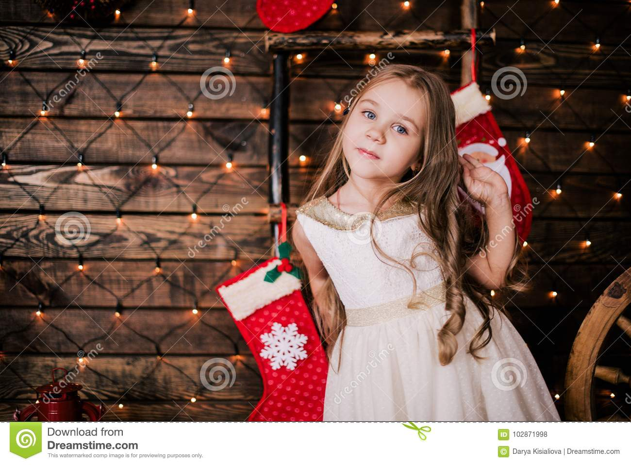 1d5ed8930 Baby Girl 4-5 Year Old Posing In Room Over Christmas Tree With ...