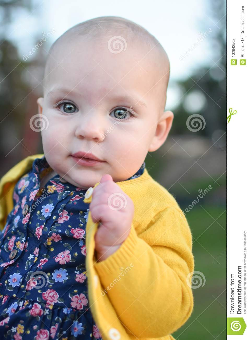 baby girl in yellow stock photo. image of sucking, yellow - 102642502