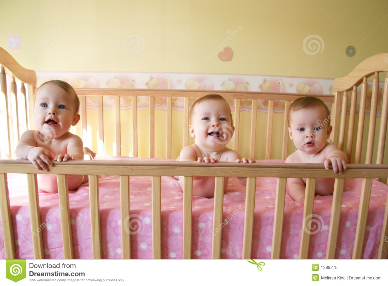 Crib for triplet babies - Baby Girls In Crib Triplets Royalty Free Stock Photo