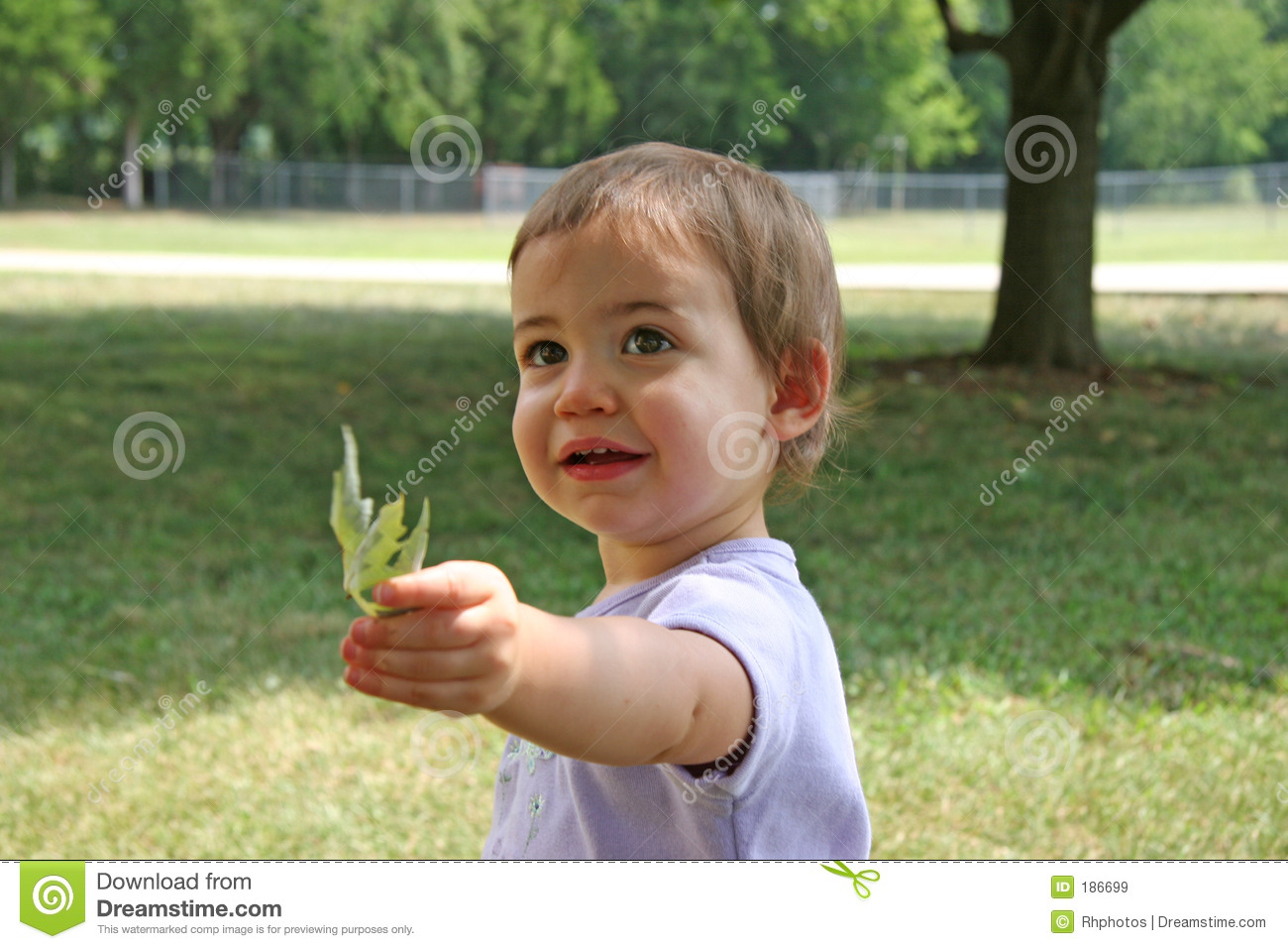 Baby giving leaf