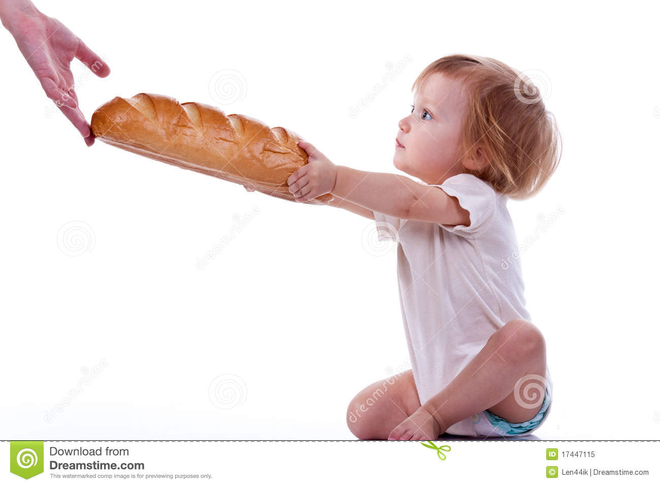 Baby giving out a loaf of bread royalty free stock photo image