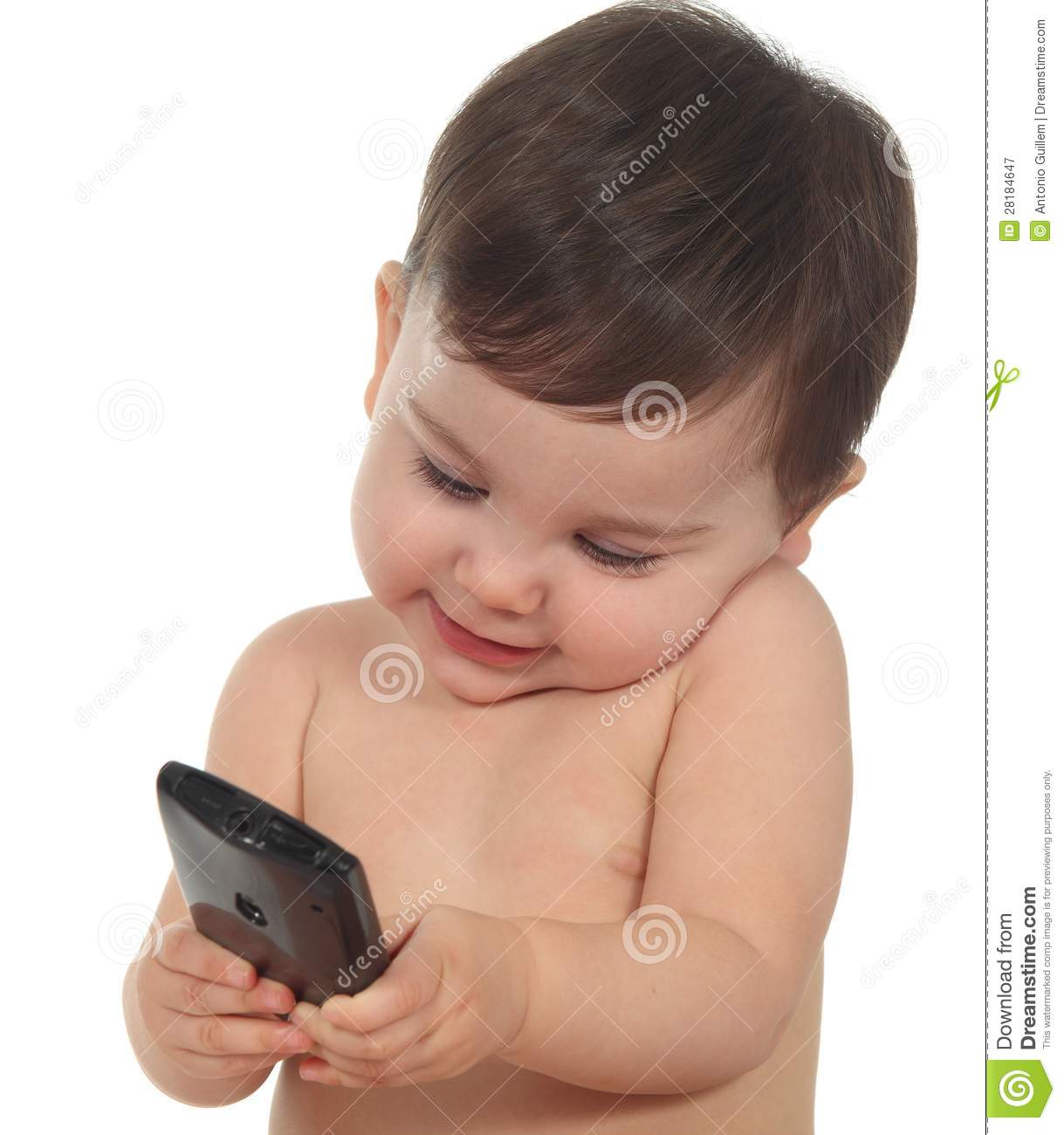 Baby Happy And Concentrated In A Mobile Phone Royalty Free ...