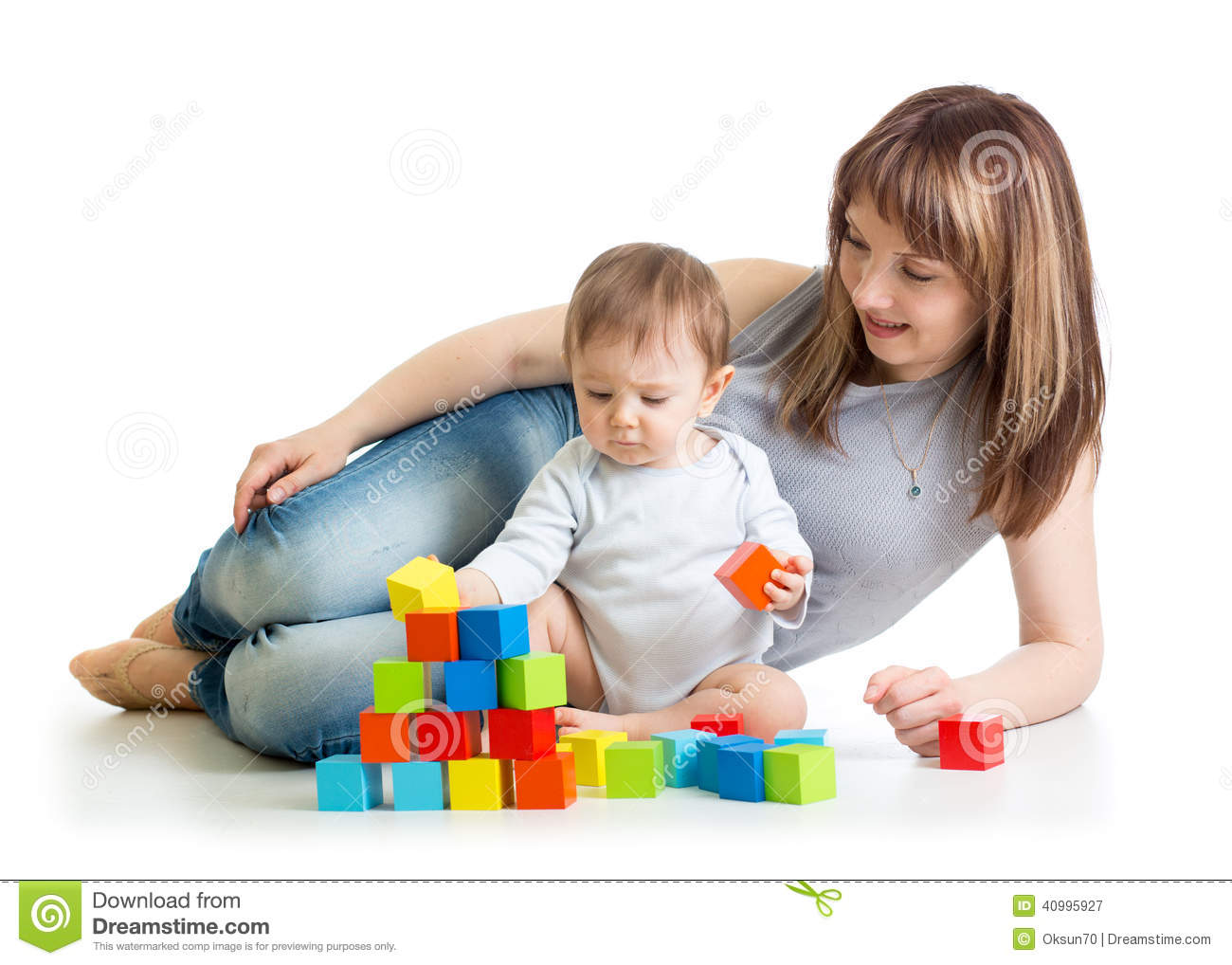 Mom Play Toys : Happy baby boy sitting with his toys stock photo