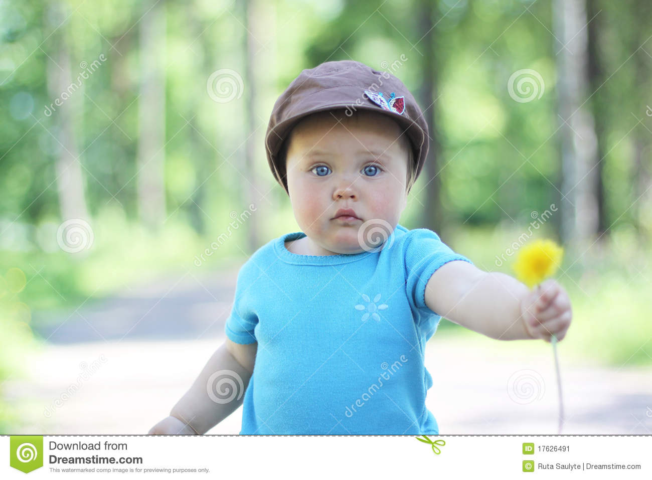 A baby holding a flower stock image. Image of yellow - 17626491