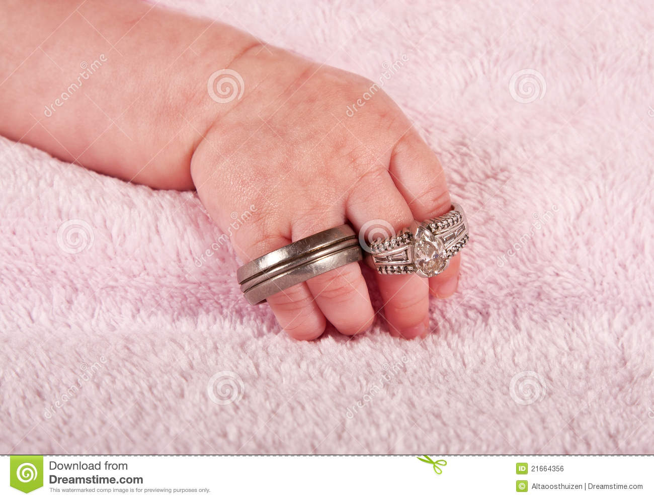 Baby Holding Wedding Rings Stock Photos - Download 100 Images