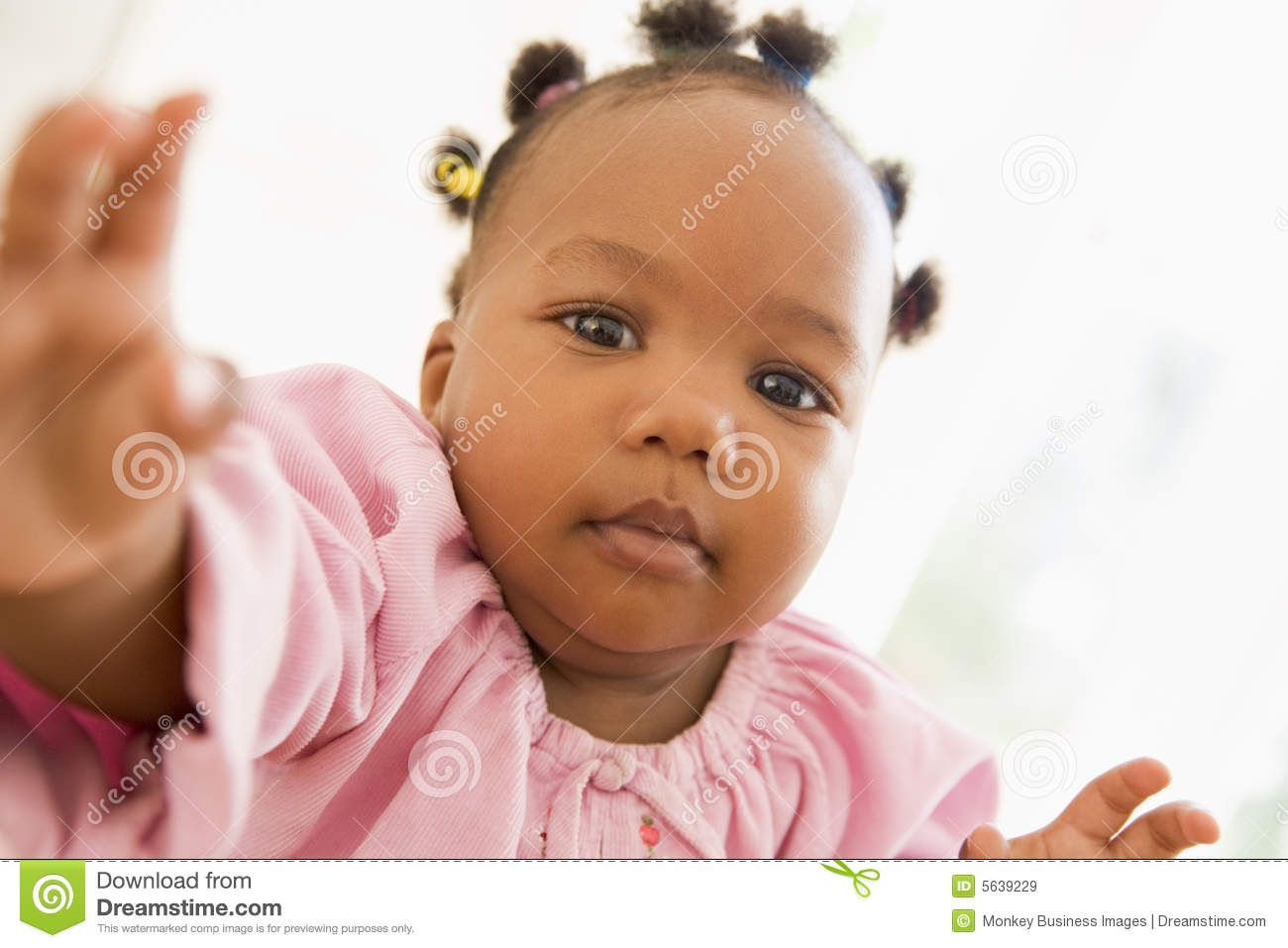 Baby indoors reaching hand out royalty free stock images image