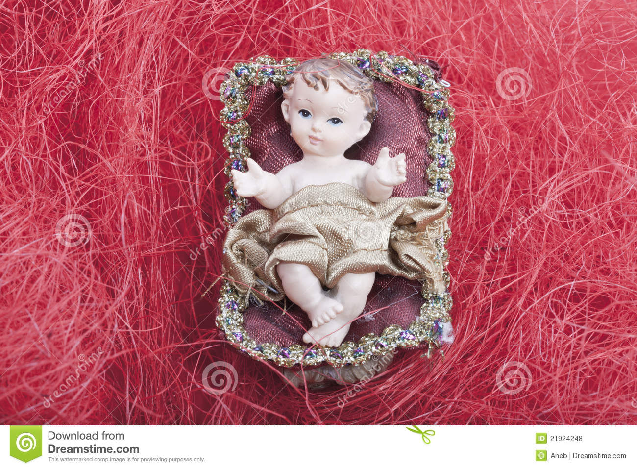 Cradle with baby jesus in a bethlehem home at christmas on red