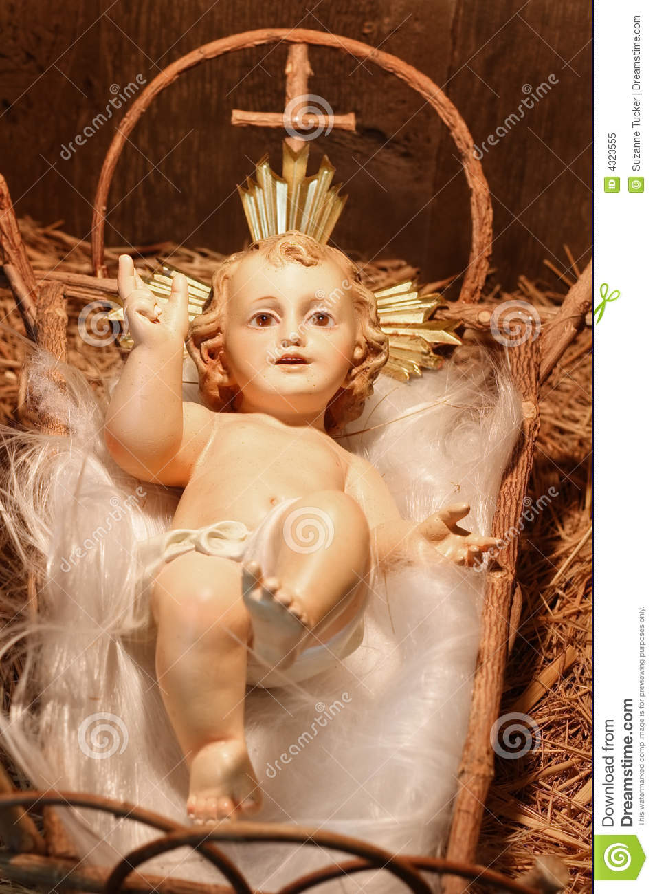 ... Plaster Baby Jesus in the Manger (closeup of a Nativity scene